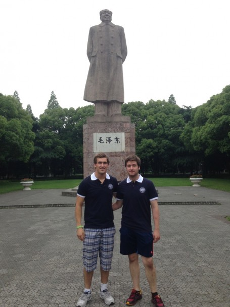 Joshua Neill and JJ Bassette standing in front of the Mao Zedong Statue