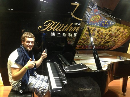 JJ Bassette at a piano store in Shanghai