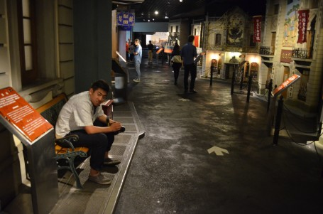 : Cliff is resting on a bench in old Shanghai as part of the museum