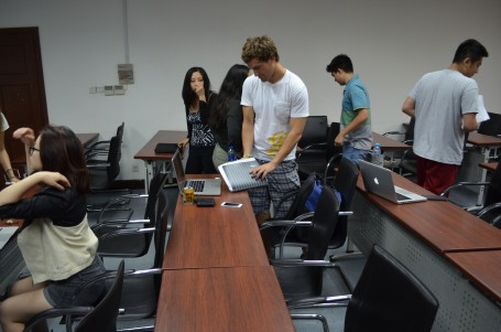 Students mulling around during a break in lecture on Thursday afternoon