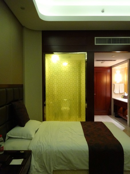 A glass wall between shower and hotel room in Hengdian.