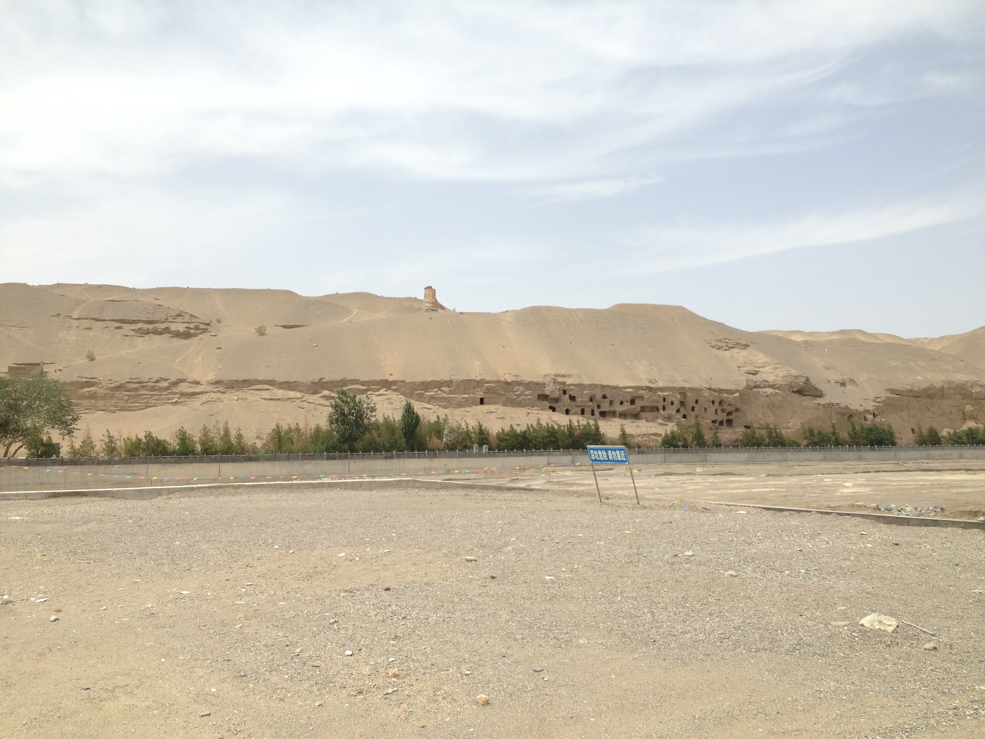 Sandstone cliffs being excavated near Mogao Grottoes in Dunhuang, June 9