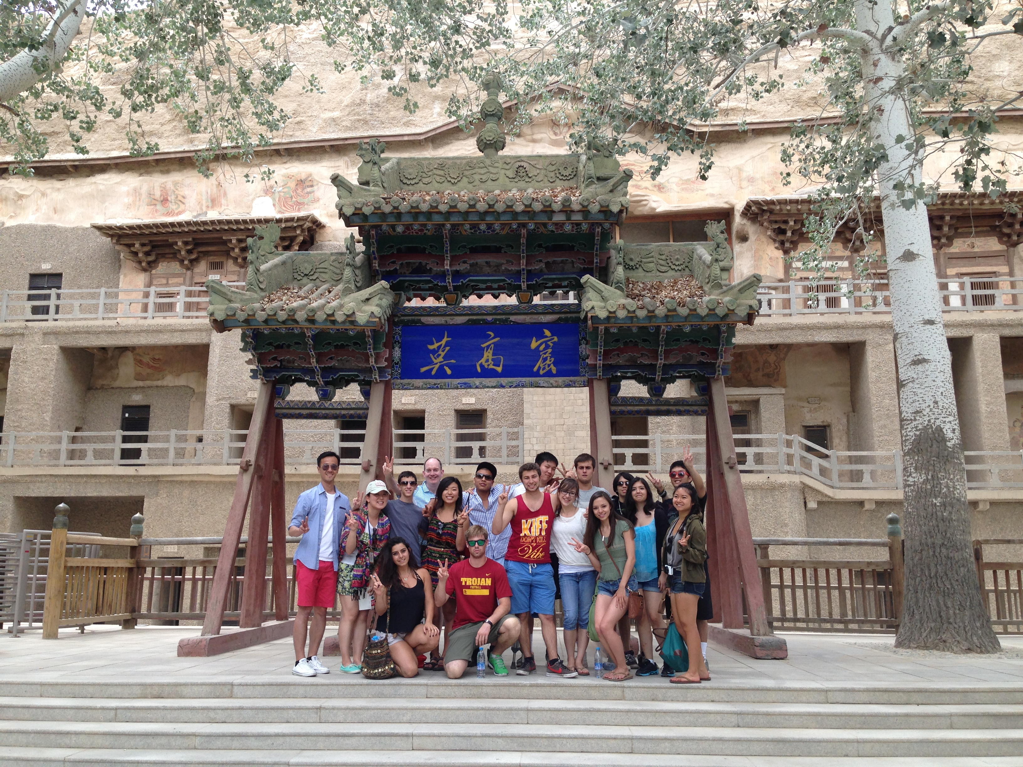 Group Photo in Front of the Mogao Grottoes in Dunhuang, June 9
