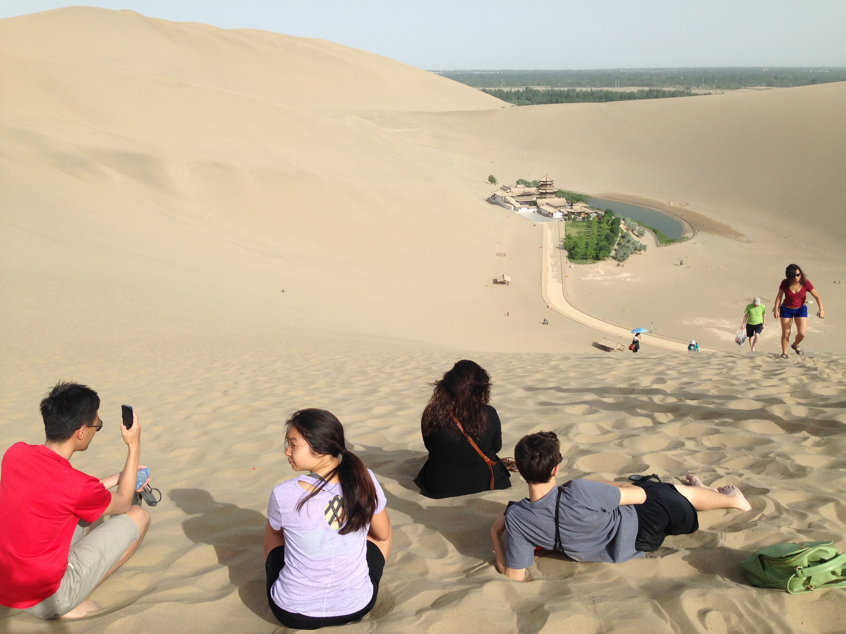 View from the top of the Singing Dunes looking down at Crescent Lake in Dunhuang, June 10