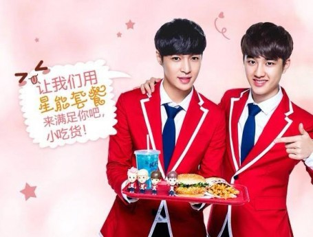 This ad shows 2 members from the South Korean pop boy group, EXO, posing with the StarPower combo and gift meal for the Chinese KFC's most recent celebrity endorsement campaign.