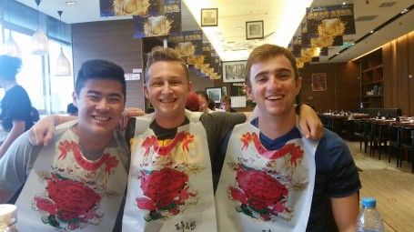 Brandon Cheung, Jacob Lokshing, and Rowan McEvoy enjoy dinner.