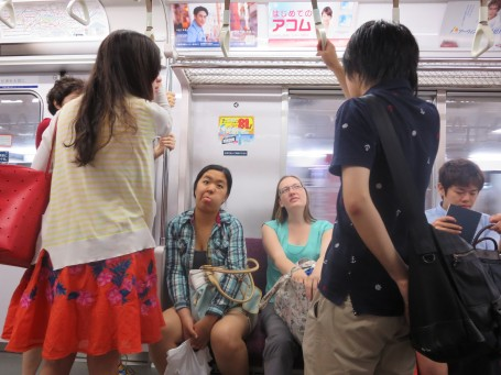 USC students talking with Meiji students on the train.
