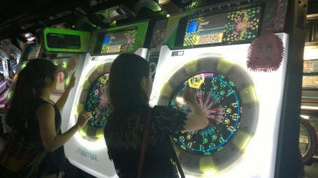 A Rhythm game being played by Lisa and Sarah
