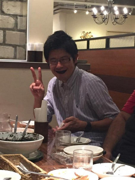 Toku after eating the squid ink pasta during dinner