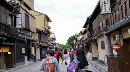 exploring the bustling streets of Kyoto