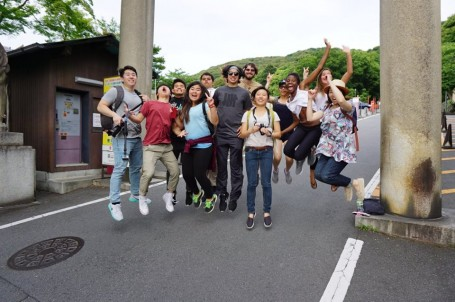 Jumping in front of Kannon statue