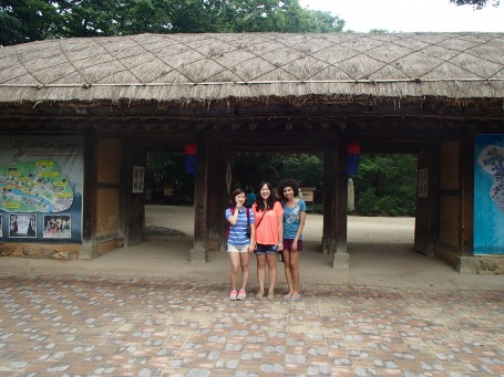 Yuni, Melina, and Ari outside of the folk village
