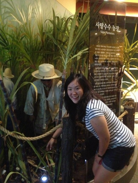 Melina posing with a model of a Korean plantation worker!