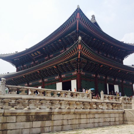 Geunjeongjeon(근정전) is the place where the king met the officials, greeted foreign visitors and gave national announcements. The ancient Korean architecture style is different from the Chinese and Japanese ones in terms of colors, locations, etc. When the Korean king was building the palace, he didn't destroy the environment around the location because Koreans believe that they are a part of the nature. The palace is surrounded by mountains in four different directions, and there are rivers crossing the palace. Rooflines are mildly curvy upwards, and the number of statues placed on top of the rooflines represents the rank of the building.