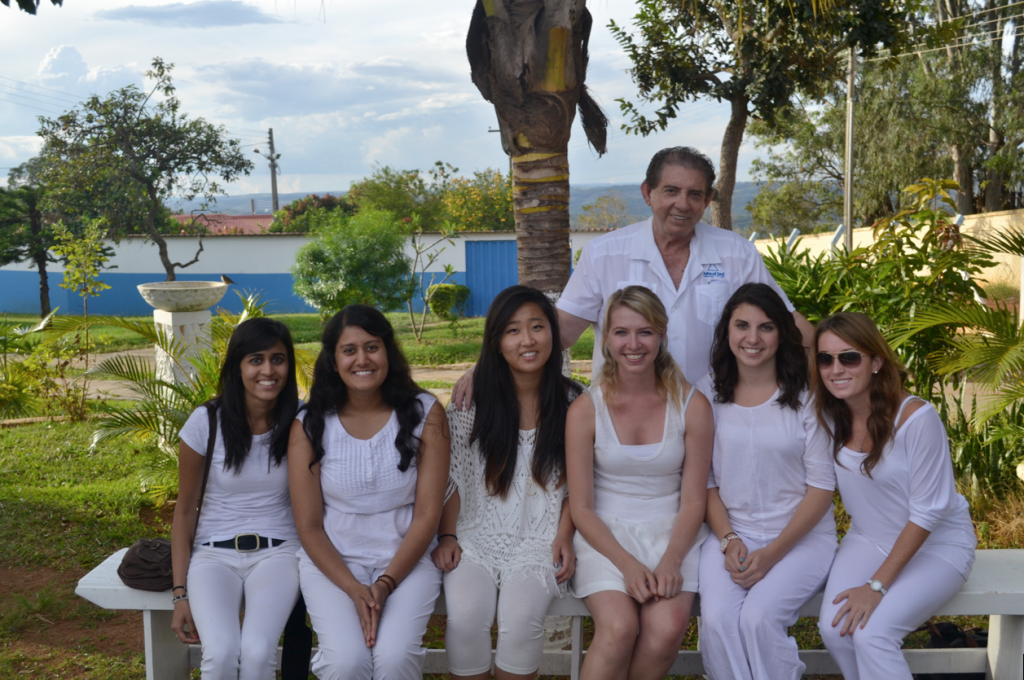 John of God pictured with some of the PWP group in a garden at the Casa. PC: Amita Risbud.