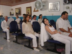 "Visitors in white meditate in one of the Casa ""current rooms.""  Meditation is seen as a central healing modality.  Photo: E. Moore"