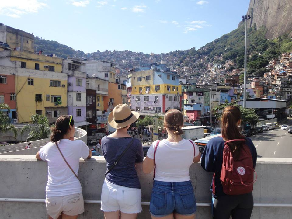 Students looking over Rio's crowded Rocinho favela.