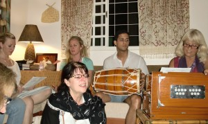 Author, Adwight, center with tabla