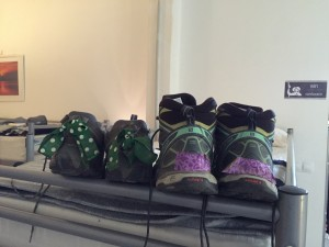 Author's shoes (left). The green and polka dot bows keep shoes from being confused with other shoes in the racks outside dorms.