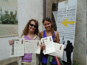 The author with her daughter Marika showing off the Compostelas in 2015.