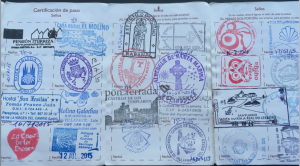 A pilgrim passport with stamps from along the Way